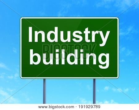 Industry concept: Industry Building on green road highway sign, clear blue sky background, 3D rendering