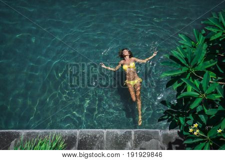 Swimming girl in the pool