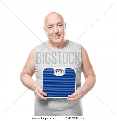 Fat senior man with scales on white background. Weight loss concept