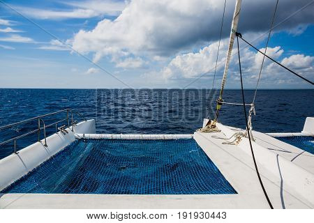 Sailing yacht catamaran sailing in the sea. Sailboat