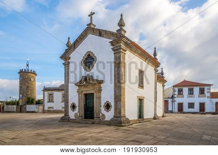 View at the square with Chapel and Tower clock in Rates - Portugal