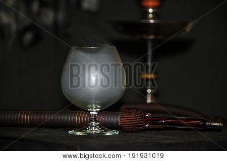 Heavy Hookah Smoke In A Brandy Glass On A Gray Background, Hookah Tube