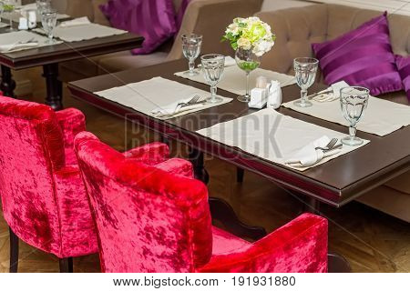Elegant served table with wine glasses in modern restaurant