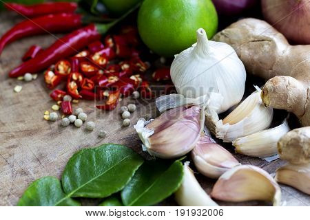 Food ingredient ginger chili pepper and garlic on wooden table asian food cooking concept.