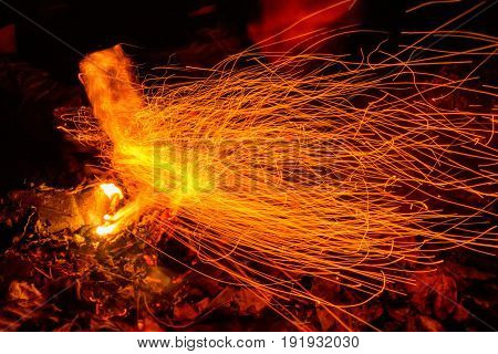Closeup picture of speed fire trajectories taken with slow shutter