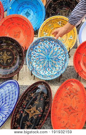 Decorative color dishes at souvenir shop at oriental marketplace