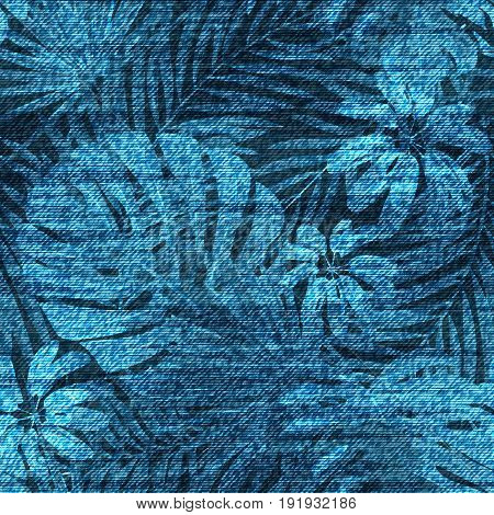 Vector denim exotic leaf seamless pattern. Faded jeans background with tropical plants. Blue jeans cloth background