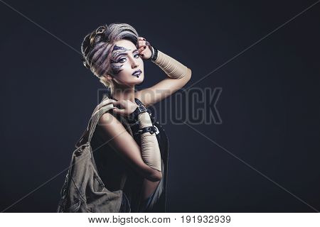 Woman Beautiful Model With Body Art On The Face Of Unusual And Fashionable Clothing