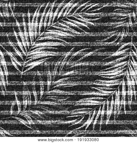 Vector denim exotic palm leaf seamless pattern. Faded jeans background with tropical plants. Gray jeans cloth background