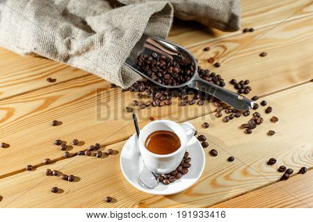 Coffee beans and coffee cup espresso. on a wooden table