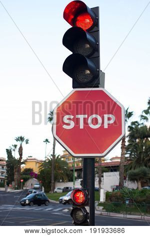 Stop sign. Road traffic means attention. Traffic light. Red color