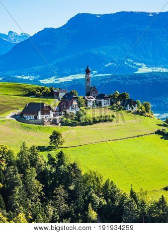 Travel to the magic fantastic country. The charming small village in the Dolomites. Concept of ecological and ethnographic tourism.