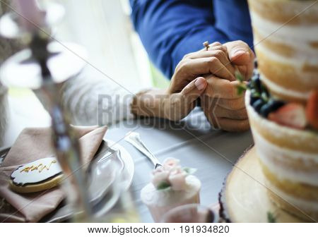 Newlywed Couple Holding Hands Together