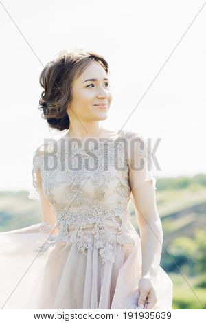 Portrait of a beautiful bride in the nature. fine art photography.