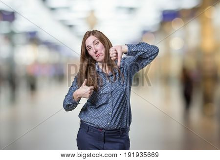 Pretty Business Woman Doing Bad And Good Sign Over Blur Background..