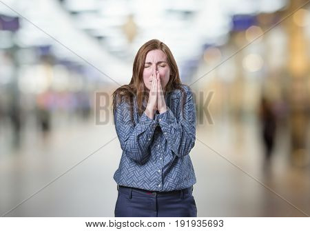 Pretty Business Woman Pleading Over Blur Background