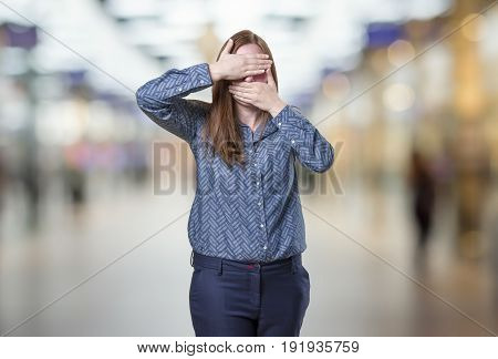 Pretty Business Woman Covering Her Face Over Blur Background