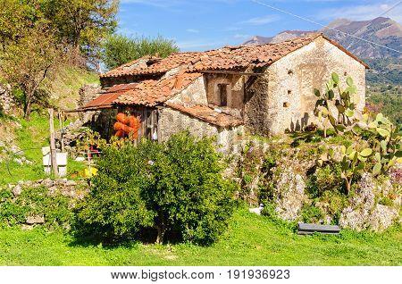 Tumbledown cottage up on the slopes in Basilicata Italy