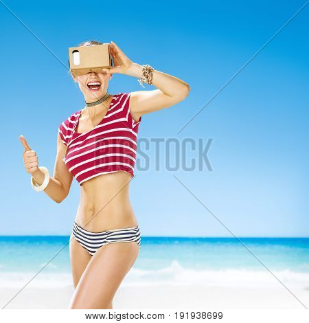 Woman Showing Thumbs Up And Wearing Virtual Reality Gear
