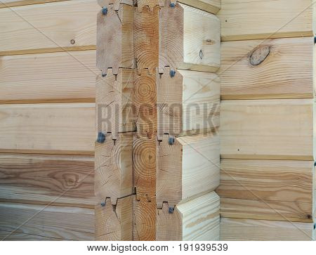 detail of ecological wooden house from timber beam construction.