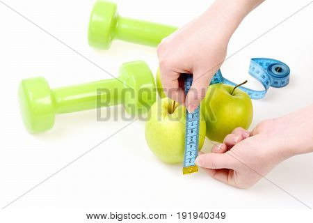 Tape For Measuring Rolled In Female Hands Measures Apples