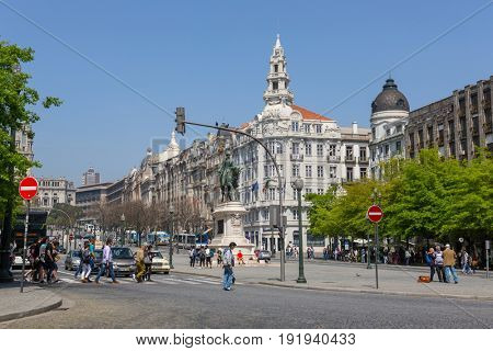 PORTO, PORTUGAL - April 17, 2017: People walking at Old Town streets of Porto. Porto is a famous tourist destination in Portugal