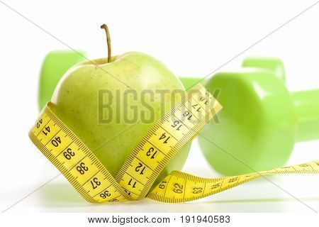 Tape For Measuring In Yellow Color Wrapped Around Green Apple