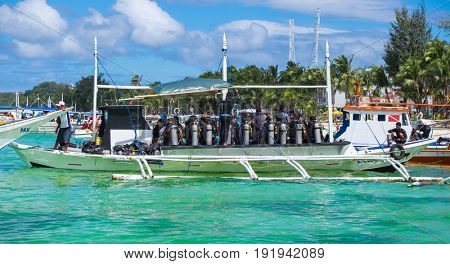 Boracay, Philippines - February 25, 2016: Divers at diving boat at famous White Beach on Boracay Island, Philippines
