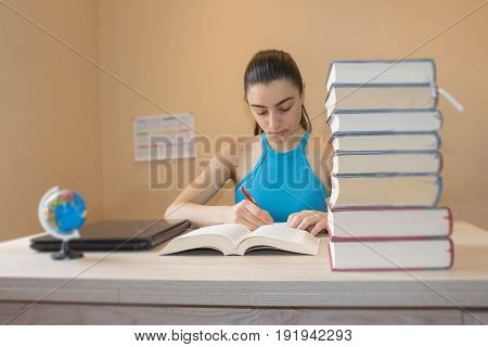Student Young Girl Studying At Home With A Lot Of Books