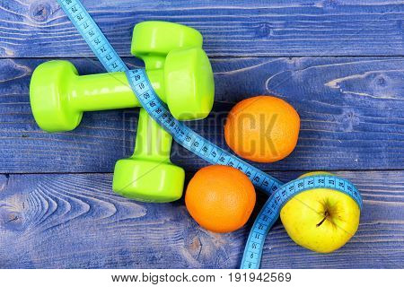 Sport And Health Concept, Dumbbells Weight With Measuring Tape, Fruit