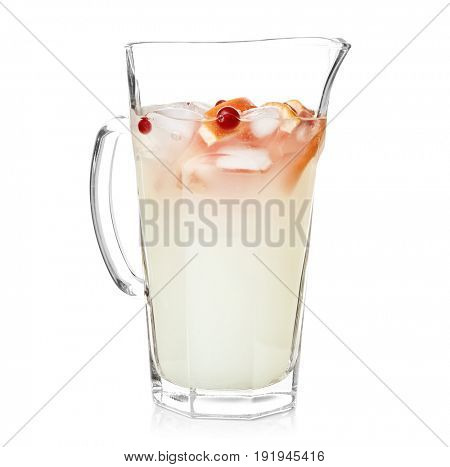 Tasty refreshing lemonade with grapefruit and cranberry in glass jug on white background