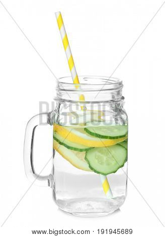 Tasty refreshing lemonade with cucumber in mason jar on white background