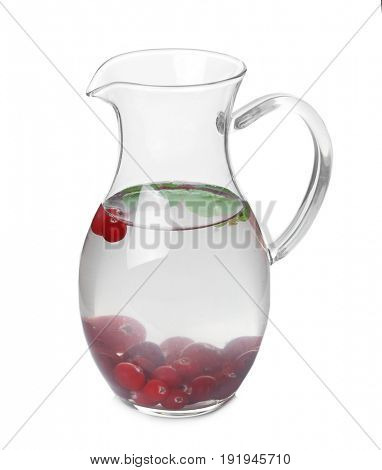 Tasty refreshing lemonade with cranberry in glass jug on white background