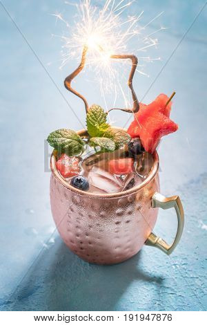American Patriotic Cold Moscow Mule cocktail with watermelon and blueberry