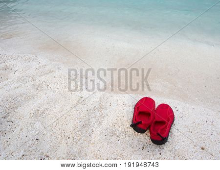 Pair Of Swimming Shoes On Sea Coast