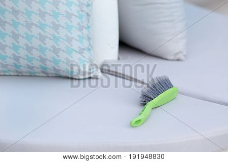 Cleaning Brush On Outdoor Furniture