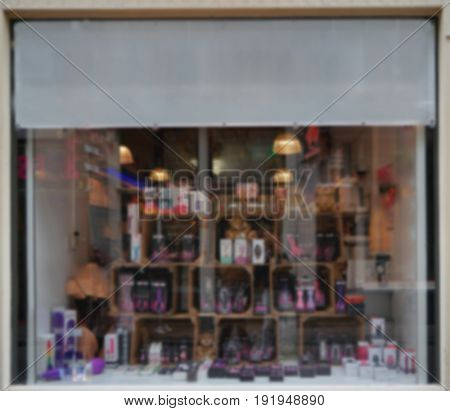 Blurred view of sex shop showcase, outdoors