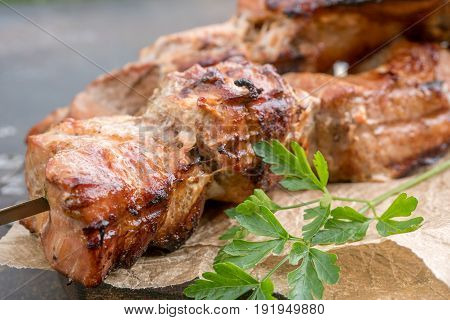 Grilled shish kebab or shashlik pork meat on skewers closeup on white background
