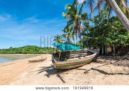 Wooden boat on the beach in a fishing village on Nosy Be island Madagascar Africa