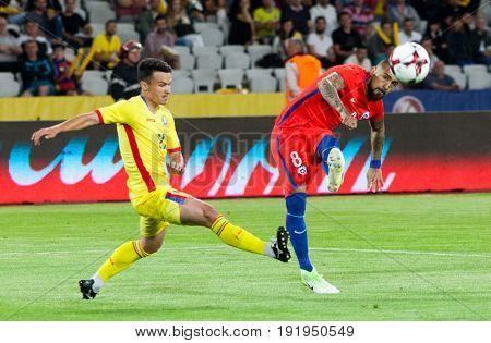 CLUJ-NAPOCA, ROMANIA - 13 JUNE 2017: Chile's Arturo Vidal (L) in action during the Romania vs Chile friendly, Cluj-Napoca, Romania - 13 June 2017