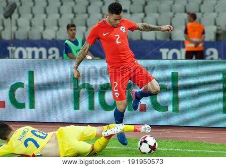 CLUJ-NAPOCA, ROMANIA - 13 JUNE 2017: Sergiu Hanca (L) of Romania fights the ball with Eugenio Mena of Chile during the Romania vs Chile friendly, Cluj-Napoca, Romania - 13 June 2017