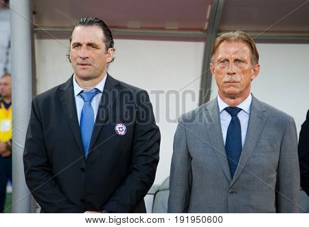 CLUJ-NAPOCA, ROMANIA - 13 JUNE 2017: Juan Antonio Pizzi, Chile's coach and Christoph Daum, Romanian national football team head coach during the national anthems ahead of the Romania vs Chile friendly