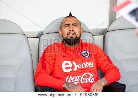 CLUJ-NAPOCA, ROMANIA - 13 JUNE 2017: Arturo Vidal (R) of Chile on the bench before Romania vs Chile friendly, Cluj-Napoca, Romania - 13 June 2017
