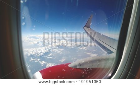 The view through the window at the beautiful clouds and the plane