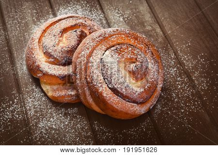 Sweet Buns On A Wooden Background