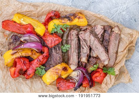 Grilled Beef Steak Fajitas with colorful bell peppers on a table