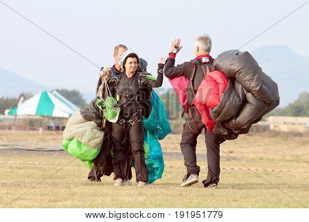 Skydiving Team Giving Each Other High Five After Successful Artistic Jump