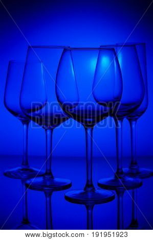 Set of wine glasses on blue background