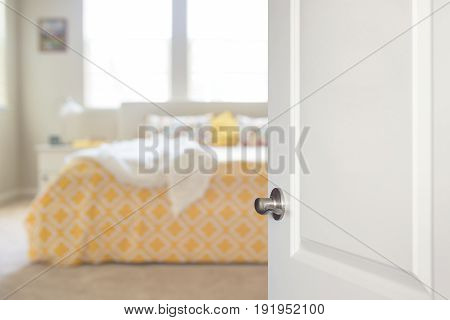 Welcome to warm and cozy bedroom, all yellow and beige, sunny and airy. Just open the door and come in.