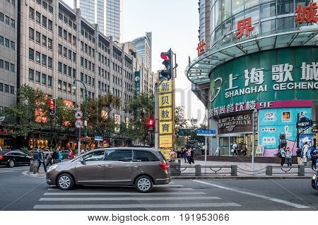 Shanghai, China - Nov 4, 2016: On intersection of Fengyang Road and Xizang Road (Middle) - in late afternoon sunlight. Street photography.